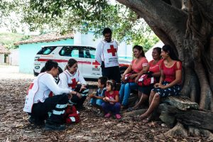 Красным Крестом